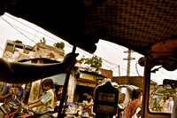 Auto Rickshaw Driving Past a Slum