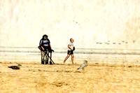 man jogging and man with metal detector on beach