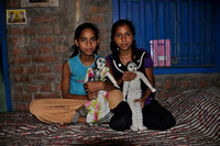 nine year old village cousins with their handmade dolls