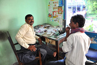 Village Doctor with Patient